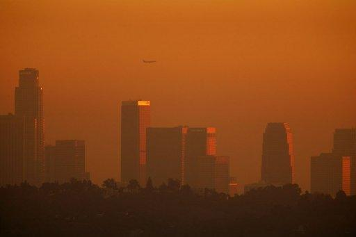 File picture shows the downtown skyline enveloped in smog shortly before sunset in Los Angeles, California. Harmful carbon emissions from burning fossil fuels made their biggest ever annual jump in 2010, according to the US Department of Energy's latest world data released this week