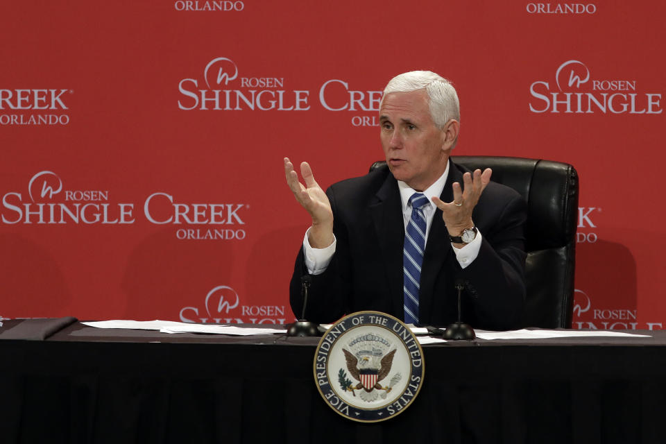 Vice President Mike Pence gestures as he participates in a roundtable discussion with hospitality and tourism industry leaders to discuss their plans for re-opening during the coronavirus outbreak Wednesday, May 20, 2020, in Orlando, Fla. (AP Photo/Chris O'Meara)