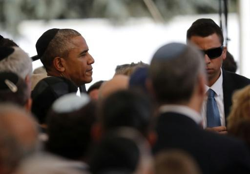Obama: Abbas presence at Peres funeral shows 'unfinished business of peace'