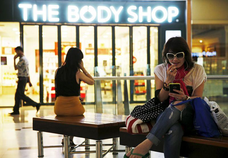 A woman use her smartphone at the Grand Indonesia mall in Jakarta