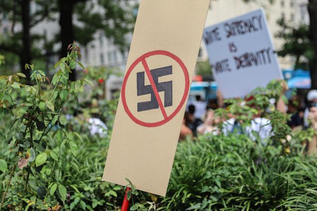 <p>A anti-Nazi sign stands as counter protesters gather at Freedom Plaza before the Unite the Right rally in Lafayette Park on August 12, 2018 in Washington, DC. Thousands of protesters are expected to demonstrate against the 'white civil rights' rally, which was planned by the organizer of last year's deadly rally in Charlottesville, Virginia. (Photo: Alex Wroblewski/Getty Images) </p>