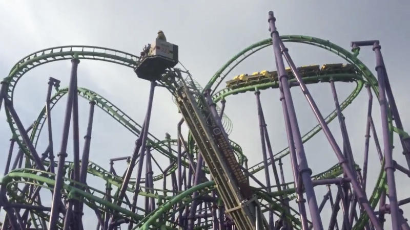 Rescuers pluck passengers from stuck roller coaster