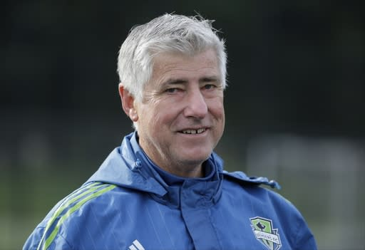 FILE - In this Oct. 27, 2015, file photo, Seattle Sounders coach Sigi Schmid walks off the field following an MLS soccer training session in Tukwila, Wash. Nearly two years after he died, Schmids presence and influence is being heavily felt heading into Saturdays MLS Cup final between Columbus and Seattle. (AP Photo/Ted S. Warren, File)