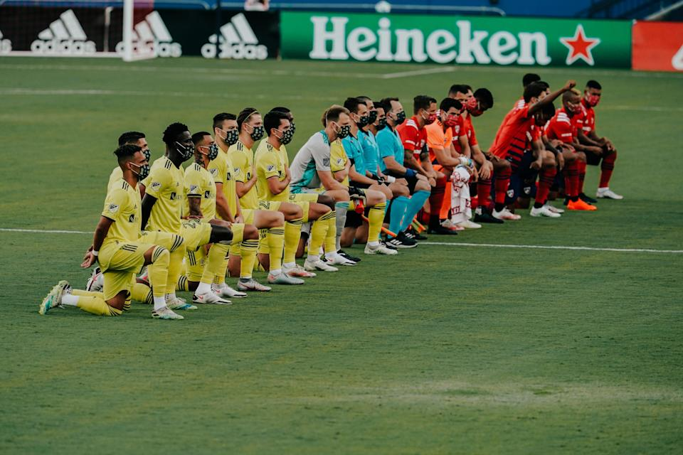 Nashville SC and FC Dallas players kneel during national anthem ahead of MLS match Aug. 12, 2020 at Toyota Stadium in Frisco, Texas.