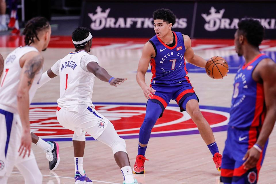Pistons guard Killian Hayes dribbles against Clippers guard Reggie Jackson during the first half at Little Caesars Arena in Detroit, Wednesday, April 14, 2021.