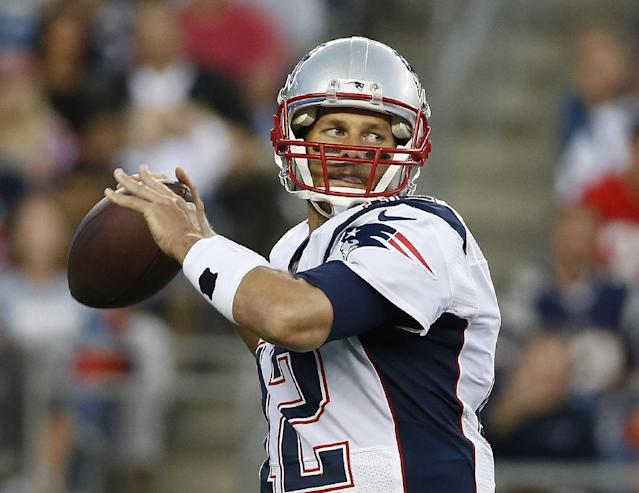 New England Patriots quarterback Tom Brady prepares to throw a pass against the Philadelphia Eagles in the first quarter of an NFL preseason football game Friday, Aug. 15, 2014, in Foxborough, Mass. (AP Photo/Elise Amendola)