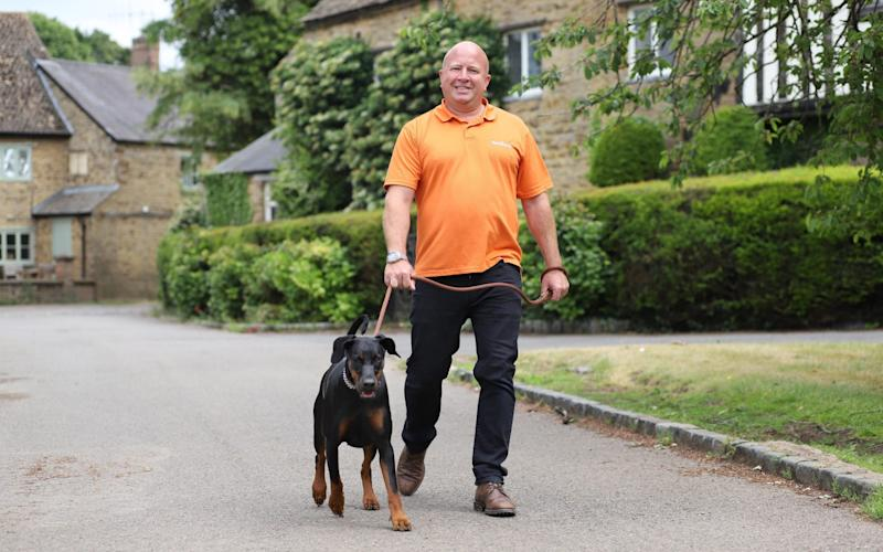 Steve Cummings and dog Bella photographed near his home close to Banbury in Oxfordshire - John Lawrence