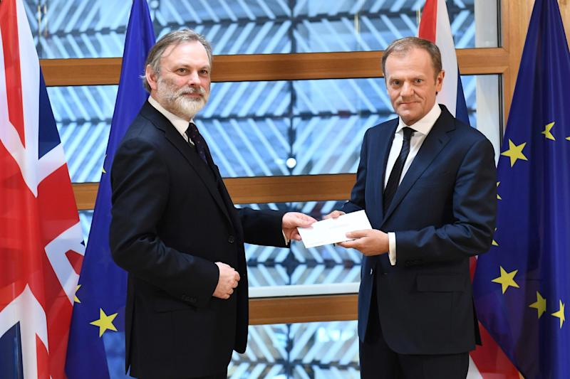 Delivery: the letter invoking Article 50 is handed to European Council President Donald Tusk, right, by Britain's ambassador to the EU Tim Barrow: Emmanuel Dunand/AFP/Getty Images