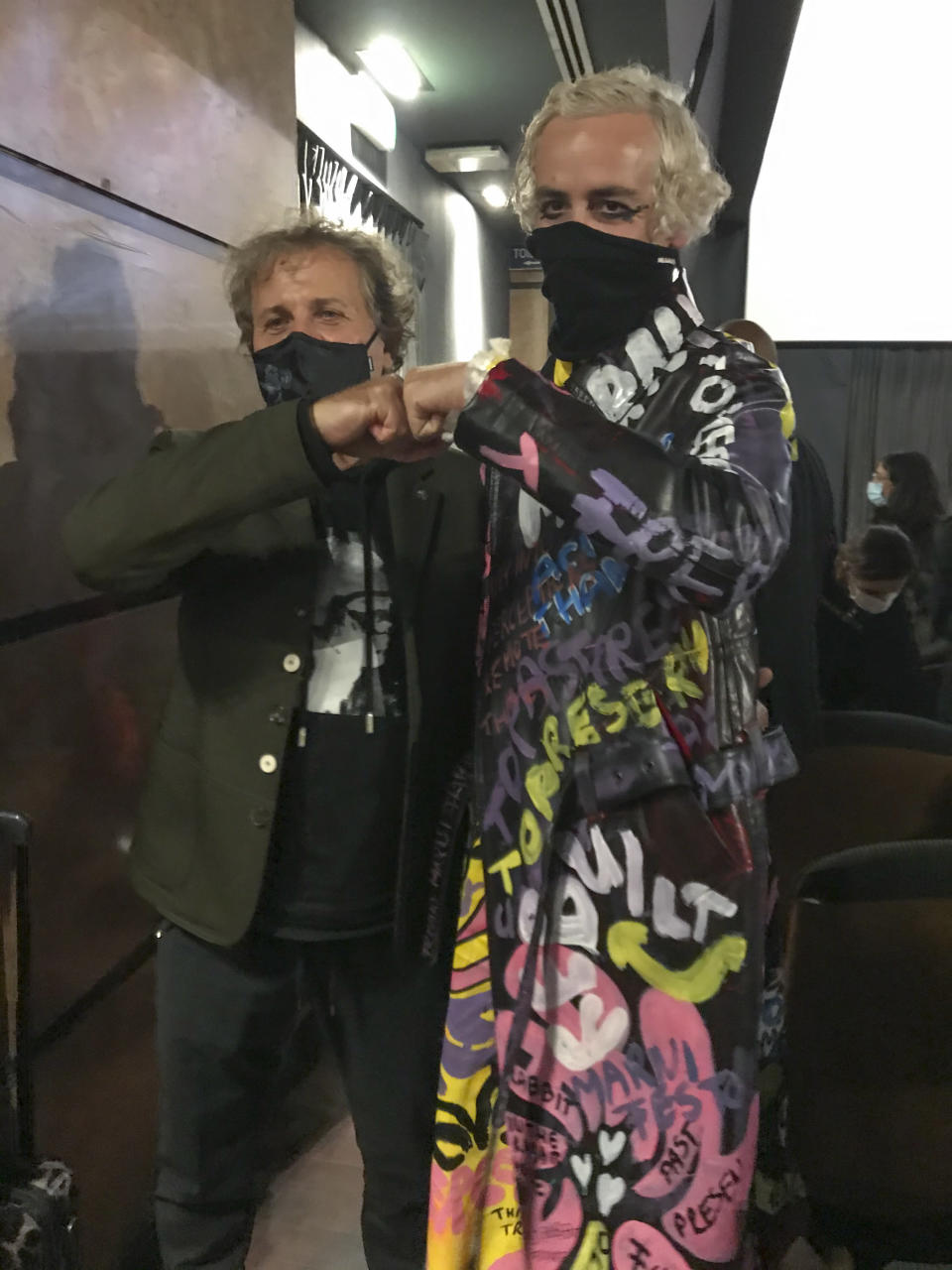 Renzo Rosso, left, and Marni creative director Francesco Risso pose after a screening of a Videos project for Milan Fashion Week, in Milan, Friday, Sept. 25, 2020. Rosso, the founder of the Diesel brand, invested in Marni in 2013. (AP Photo/Colleen Barry)
