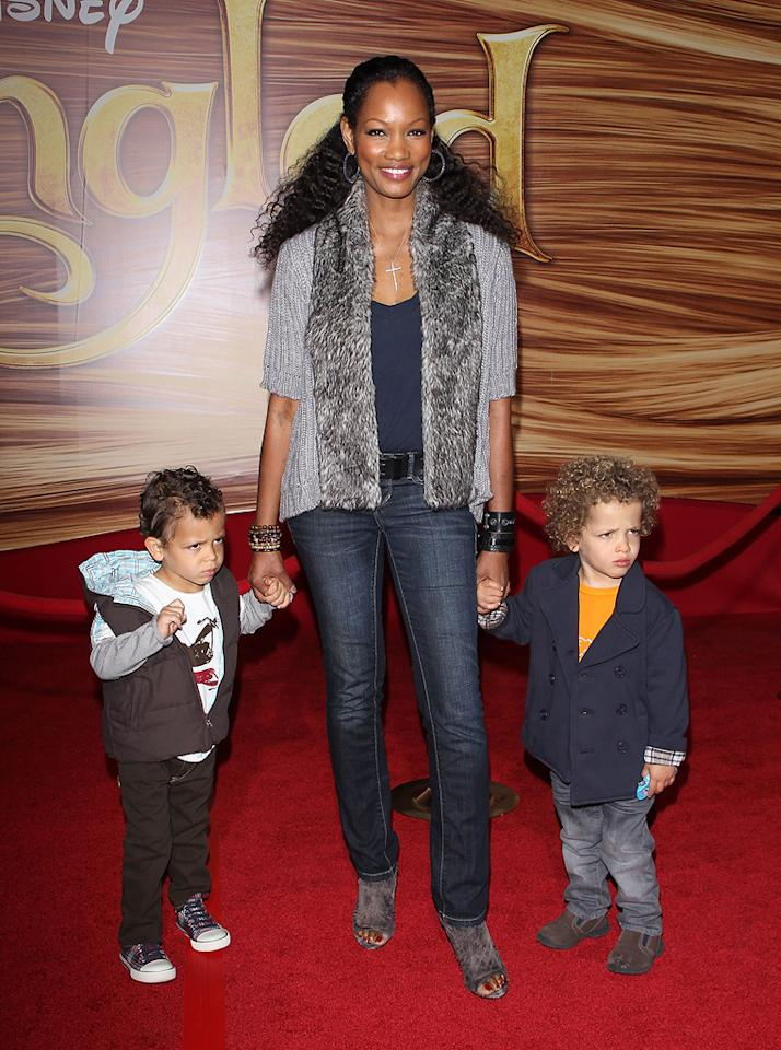 """<a href=""""http://movies.yahoo.com/movie/contributor/1807598780"""">Garcelle Beauvais</a> and sons attend the Los Angeles premiere of <a href=""""http://movies.yahoo.com/movie/1810121160/info"""">Tangled</a> on November 14, 2010."""