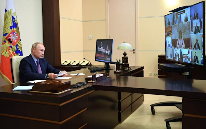 MOSCOW, REGION - JULY 29, 2020: Russia's President Vladimir Putin looks at a video screen in his office in the Novo-Ogaryovo residence during a video-conference meeting of Russian government officials to discuss the current situation in Russia in relation to the pandemic of the novel coronavirus disease (COVID-19) and the preparation of Russia's healthcare system for the autumn and winter seasons. Alexei Nikolsky/Russian Presidential Press and Information Office/TASS (Photo by Alexei Nikolsky\TASS via .) - TASS