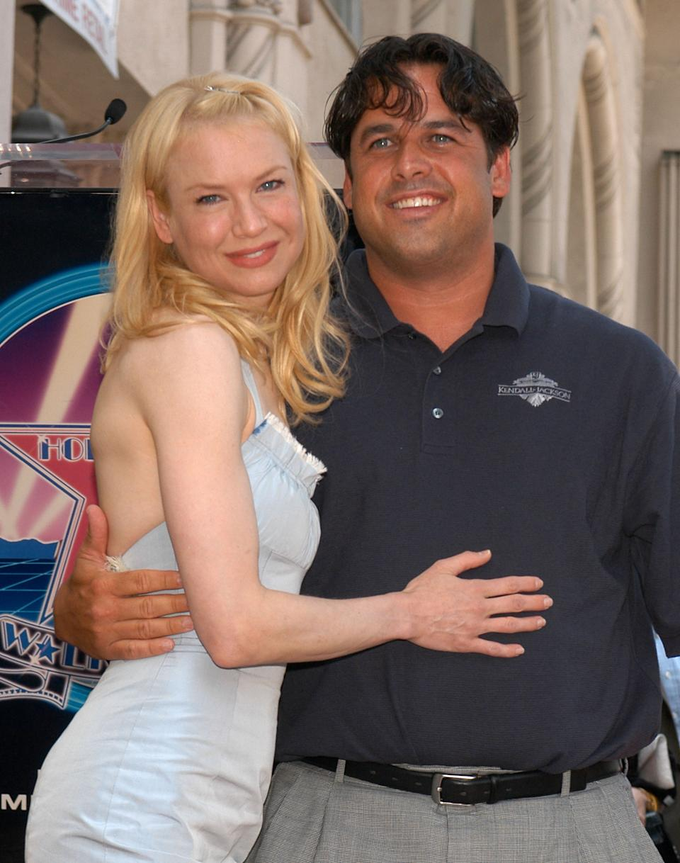 HOLLYWOOD - MAY 24:  Actress Renee Zellweger and brother Drew Zellweger pose as she receives her star on the Hollywood Walk of Fame on Hollywood Blvd. on May 24, 2005 in Hollywood, California.  (Photo by Stephen Shugerman/Getty Images)