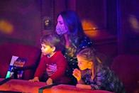<p>Inside the London Palladium, Louis perched on his mum Kate Middleton's lap while watching the show. Charlotte sat next to her little brother and mum and looked on at the stage animatedly.</p>