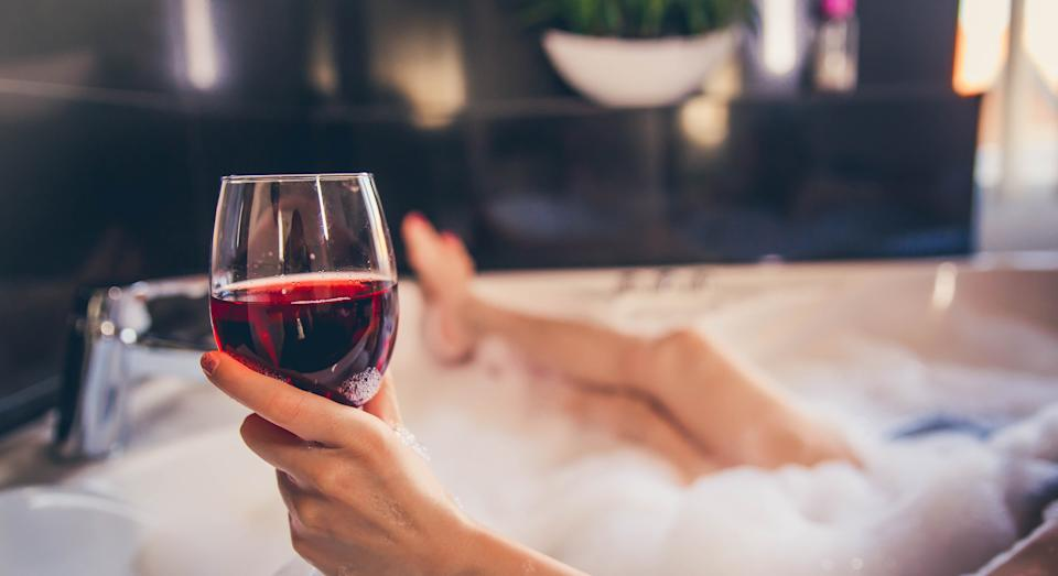 Amazon are selling an affordable wine glass holder for your bathroom [Image: Getty]