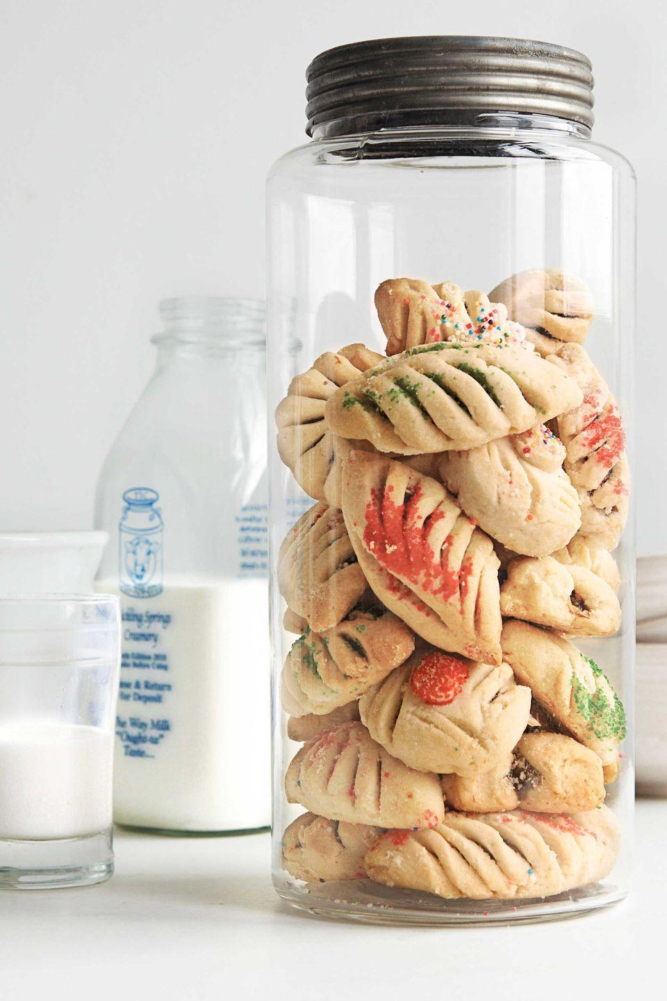 """<p>Fancify traditional sugar-cookie dough, by filling in with a mixture of figs, chocolate, and orange marmalade, then scoring a pretty fan pattern on top. </p><p><strong><a href=""""https://www.countryliving.com/food-drinks/recipes/a3767/fig-cookies-recipe-clx1211/"""" rel=""""nofollow noopener"""" target=""""_blank"""" data-ylk=""""slk:Get the recipe"""" class=""""link rapid-noclick-resp"""">Get the recipe</a>.</strong></p>"""
