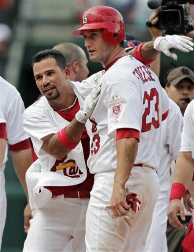 St. Louis Cardinals' Rafael Furcal celebrates with David Freese after their 5-4 win over the Miami Marlins in a baseball game, Sunday, July 8, 2012, in St. Louis. Freese scored the winning run on a single hit by Furcal. (AP Photo/Tom Gannam)