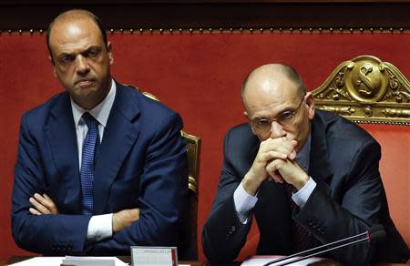 File photo of Italy's Prime Minister Letta looking on next to Interior Minister Alfano during a vote session at the Senate in Rome