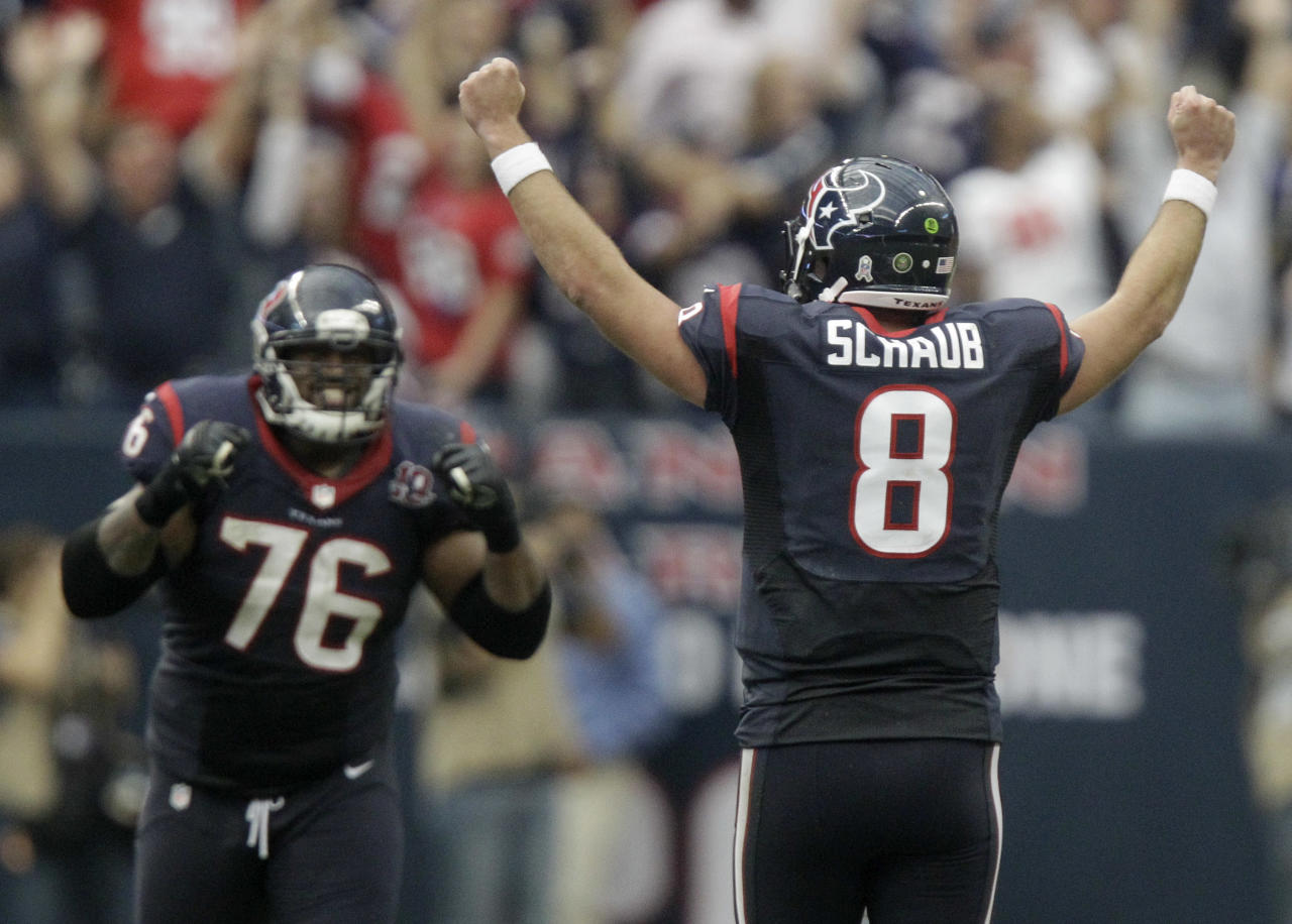 Houston Texans quarterback Matt Schaub (8) and Duane Brown (76) celebrate after beating the Jacksonville Jaguars 43-37 in overtime of an NFL football game Sunday, Nov. 18, 2012, in Houston. (AP Photo/Patric Schneider)