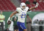 FILE - Tulsa linebacker Zaven Collins (23) celebrates after scoring a touchdown during an NCAA football game in Tampa, Fla., in this Oct. 23, 2020, file photo. Collins was selected to The Associated Press All-America first-team defense, Monday, Dec. 28, 2020. (AP Photo/Mark LoMoglio, File)