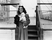 "<p>Actress Elizabeth Taylor pictured on the deck of the SS Queen Mary, holding her pet French poodle Teeny in Southampton, England.<br></p><p>Other celebrity visitors this year: Bob Hope, actress Loretta Young, Mae West, actress Barbara Stanwyek, actor Robert Taylor.<span class=""redactor-invisible-space""><br></span></p>"