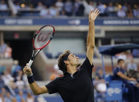 Roger Federer of Switzerland serves to Marinko Matosevic of Australia during their first round men's single match at the 2014 U.S. Open tennis tournament in New York, August 26, 2014. REUTERS/Shannon Stapleton
