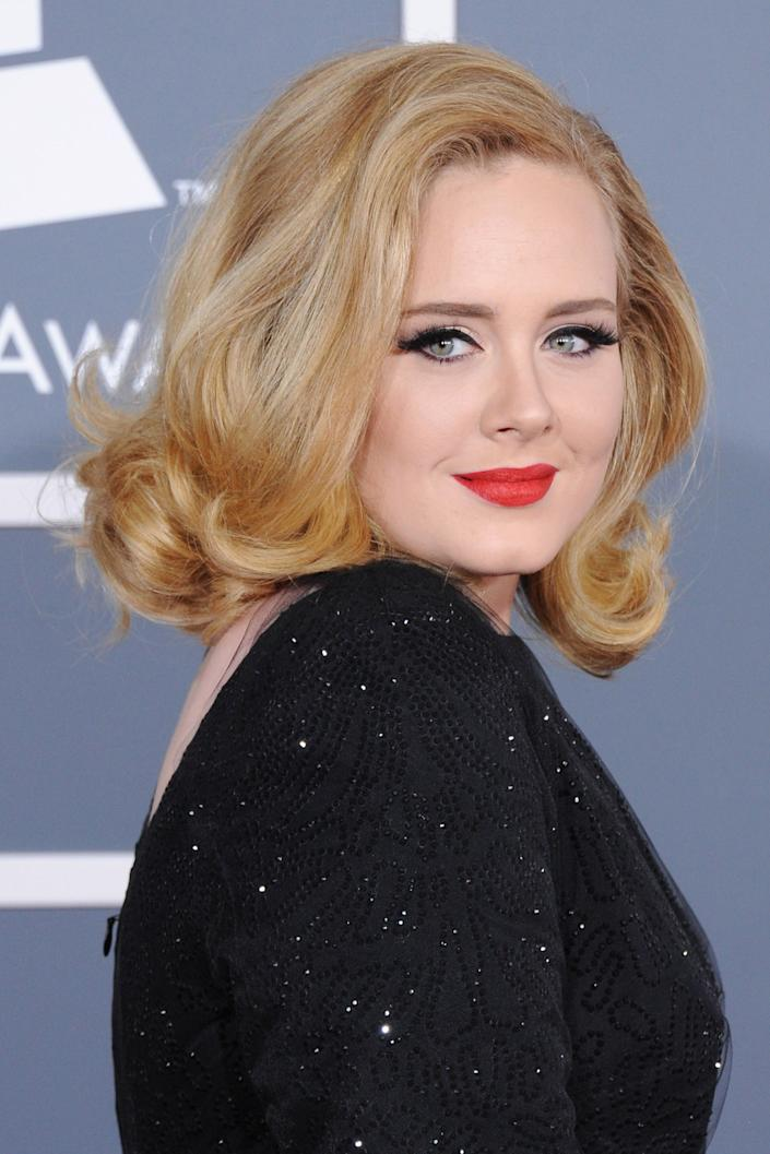 """<h3>Adele, 2012</h3><br>Paired with a bold red lip, Adele wore retro curls at the 2012 award show — a look that took center stage numerous times as she racked up six trophies. <span class=""""copyright"""">Photo: Jon Kopaloff/FilmMagic.</span>"""