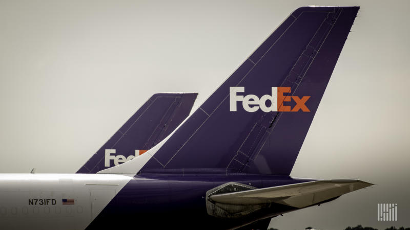 Close up of blue FedEx jet tails. FedEx pilots are upset about COVID health measures in Hong Kong.