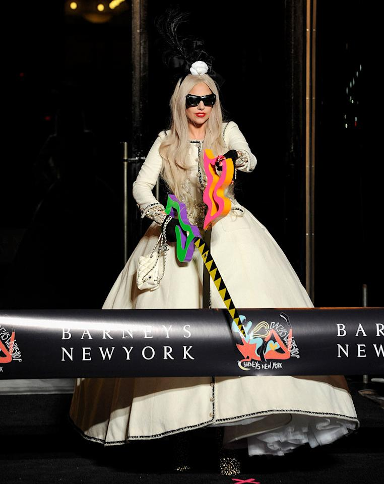 "Lady Gaga did the honors at the ribbon cutting ceremony for ""Gaga's Workshop"" at Barneys New York on Monday. The 5,500-square-foot holiday display, which takes up the entire fifth floor of Barneys, resembles Santa's workshop with a Gaga flair.  (11/21/2011)"