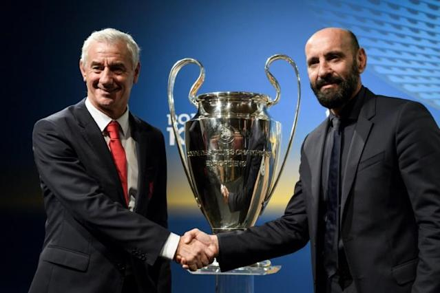 Liverpool FC club Ambassador Ian Rush (L) and AS Roma Sporting Director Ramon Monchi shake hands as they pose with the Champions League trophy