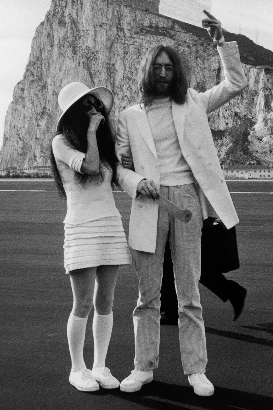 <p>Did you really think Yoko Ono would wear a conventional wedding dress to tie the knot with John Lennon? No way! The couple both wore white to the ceremony in Gibraltar. Yoko sported a miniskirt, top, floppy hat, and knee socks.</p>