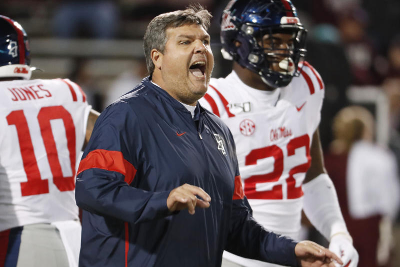 Mississippi head coach Matt Luke calls to players prior to an NCAA college football game against Mississippi State in Starkville, Miss., Thursday, Nov. 28, 2019. (AP Photo/Rogelio V. Solis)