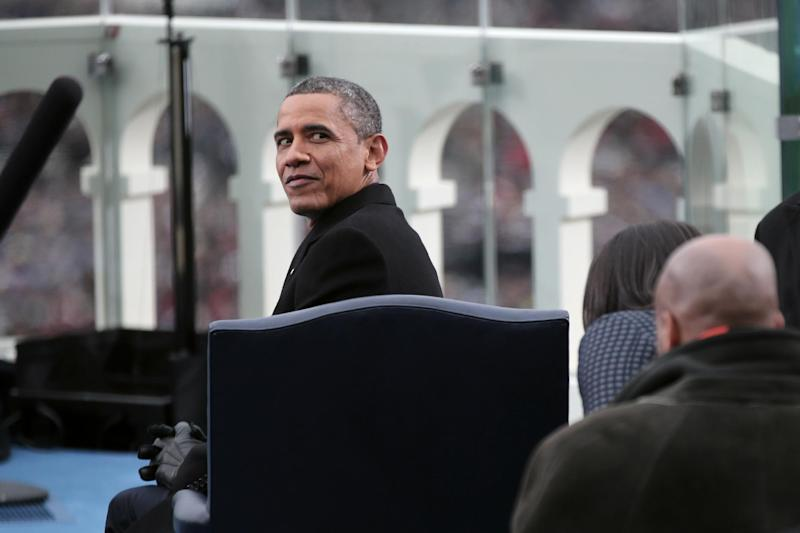 President Barack Obama looks behind him on the West Front of the Capitol in Washington, Monday, Jan. 21, 2013, prior to his ceremonial swearing-in ceremony during the 57th Presidential Inauguration. (AP Photo/Win McNamee, Pool)