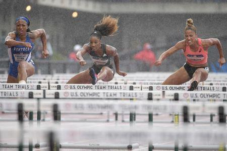 Jul 8, 2016; Eugene, OR, USA; Jasmine Camacho-Quinn (left) and Keni Harrison (middle) and Queen Harrison (right) compete during the womens 100m hurdles semifinals in the 2016 U.S. Olympic track and field team trials at Hayward Field. Mandatory Credit: Kirby Lee-USA TODAY Sports / Reuters