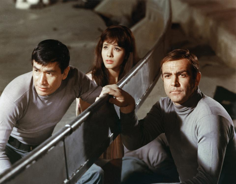 Left to right: Actors Sean Connery, Mie Hama and Tetsuro Tamba on the set of 'You Only Live Twice', directed by Lewis Gilbert, 1967. (Photo by Sunset Boulevard/Corbis via Getty Images)