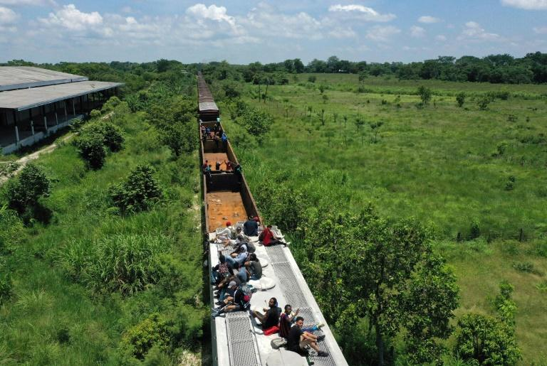 "Aerial view of migrants on a train known as ""The Beast,"" which takes them to the tourist town of Palenque"