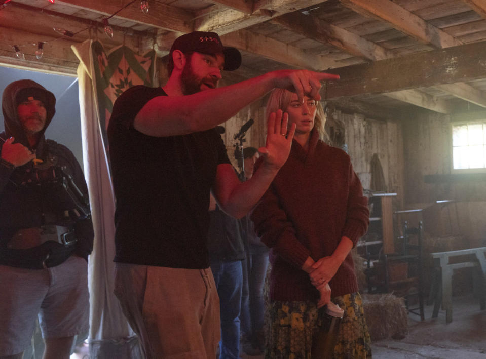 """This image released by Paramount Pictures shows director John Krasinski, left, and Emily Blunt on the set of """"A Quiet Place Part II."""" (Jonny Cournoyer/Paramount Pictures via AP)"""