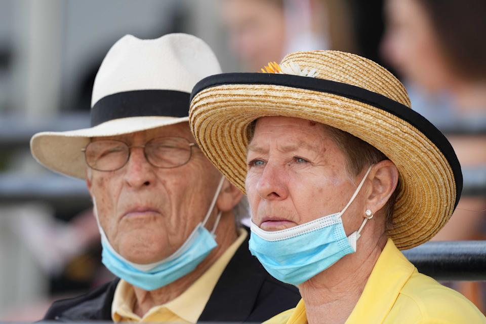 May 14, 2021; Baltimore, Maryland, USA; Spectators dress for Black-Eyed Susan Day while following COVID protocols at Pimlico Race Course. Mandatory Credit: Mitch Stringer-USA TODAY Sports