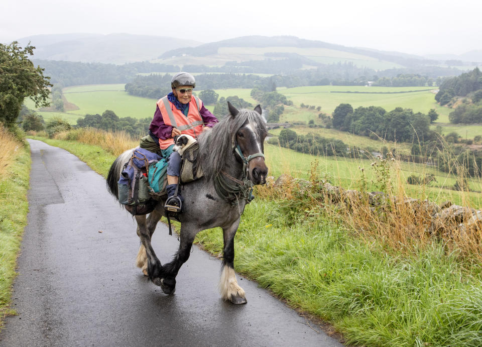 Jane Dotchin, 80, travels from Hexham to the Scottish Highlands with her horse Diamond and Dinky her disabled Jack Russell. (SWNS)