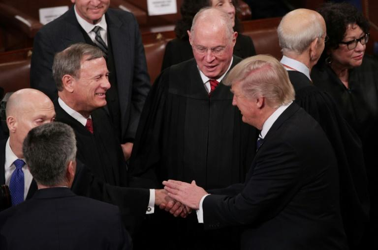 US Supreme Court Chief Justice John Roberts (L) shakes hands with President Donald Trump during Trump's 2017 State of the Union address to Congress (AFP Photo/ALEX WONG)