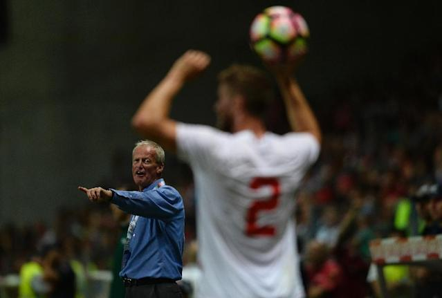Gibraltar coach Jeff Wood (L) gives instructions to defender Scott Wiseman during their friendly against Portugal (AFP Photo/Miguel Riopa)