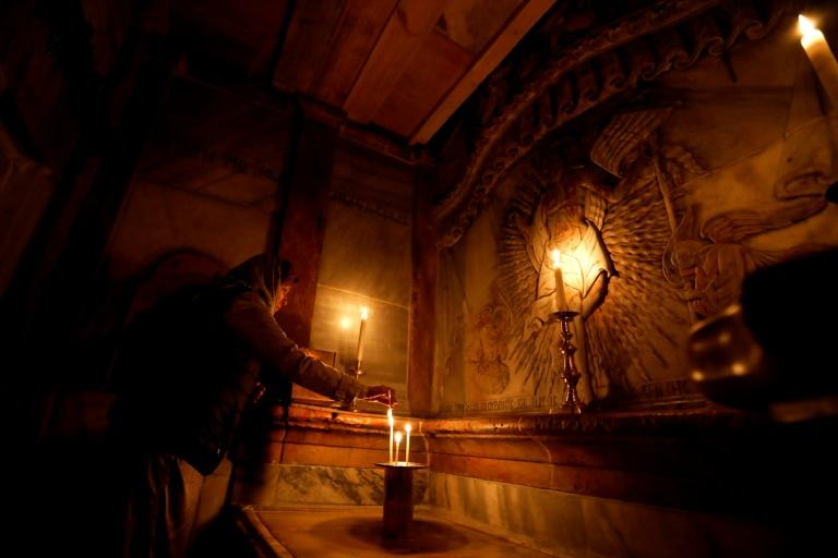 A worshipper inside the renovated Edicule in the Church of the Holy Sepulchre in Jerusalem's old city on March 20, 2017