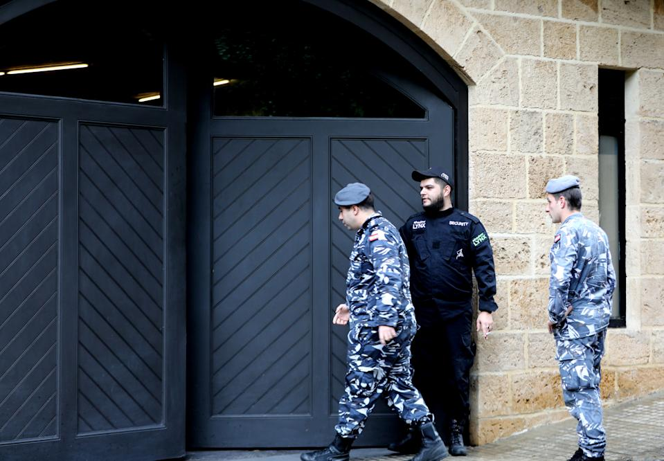 Members of Lebanon's security forces stand at the parking gate of the house identified by court documents as belonging to former Nissan chief Carlos Ghosn in a wealthy neighbourhood of the Lebanese capital Beirut on December 31, 2019. - Ghosn said today he had fled to Lebanon to escape injustice in Japan, where he was on bail awaiting trial on financial misconduct charges. The auto tycoon's abrupt departure was the latest twist in a rollercoaster journey that saw him fall from boardroom to detention centre and it sparked questions over an embarrassing security lapse in Japan. Ghosn, 65, stands accused of two counts of under-reporting his salary to the tune of 9.23 billion yen ($85 million) from 2010 to 2018, deferring some of his pay and failing to declare this to shareholders. (Photo by ANWAR AMRO / AFP) (Photo by ANWAR AMRO/AFP via Getty Images)