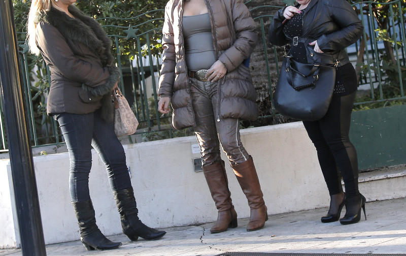 "- Prostitutes wait for clients in a street of Nice southern France, Thursday, Nov 21, 2013. France's government is pushing one of Europe's toughest laws against prostitution and sex trafficking, and other countries are watching closely. Advocates hope that a draft French law going to parliament Wednesday will help change long-held attitudes toward the world's oldest profession _ by punishing the customer and protecting the prostitute. But the bill is facing resistance in a country with a libertine reputation and a Mediterranean macho streak, and has prompted petitions defending those who buy sex. Signatories include screen icon Catherine Deneuve _who played a prostitute in the cult film ""Belle de Jour"" _ and crooner Charles Aznavour. (AP Photo)"