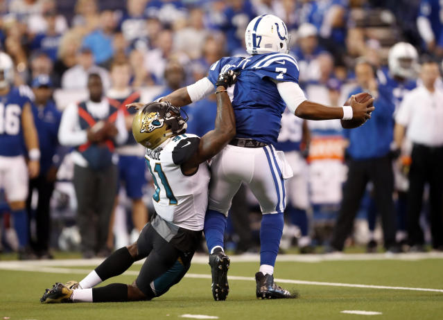 <p>Jacksonville Jaguars defensive end Yannick Ngakoue (91) ties to tackle Indianapolis Colts quarterback Jacoby Brissett (7) during the first half of an NFL football game in Indianapolis, Sunday, Oct. 22, 2017. (AP Photo/Jeff Roberson) </p>