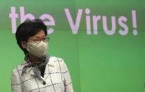 Hong Kong Chief Executive Carrie Lam arrives at a press conference in Hong Kong, Monday, July 13, 2020. Hong Kong on Monday introduced more stringent social-distancing measures, banning public gatherings of more than four and making it compulsory to wear a mask on public transport as the city battles a fresh outbreak of locally-transmitted coronavirus infections. (AP Photo/Vincent Yu)