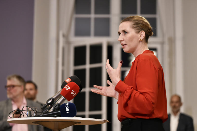 Mette Frederiksen of The Danish Social Democrats address the media after finalizing the government negotiations shortly after midnight at Christiansborg Castle in Copenhagen, Denmark, early Wednesday June 26, 2019.  Frederiksen announced that The Danish Social Democrats will form a minority government backed by three other left-wing parties. (Mads Claus Rasmussen/Ritzau Scanpix via AP)