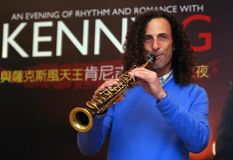 FILE - In this May 14, 2010 file photo, Kenny G, smooth jazz saxophonist, performs during a media event announcing his concert, in Taipei, Taiwan. Court records show the musician, whose real name is Kenneth Gorelick, filed for divorce on Thursday, Aug. 9, 2012 after 20 years of marriage to Balynda Helene Benson-Gorelick. (AP Photo/Chiang Ying-ying, File)