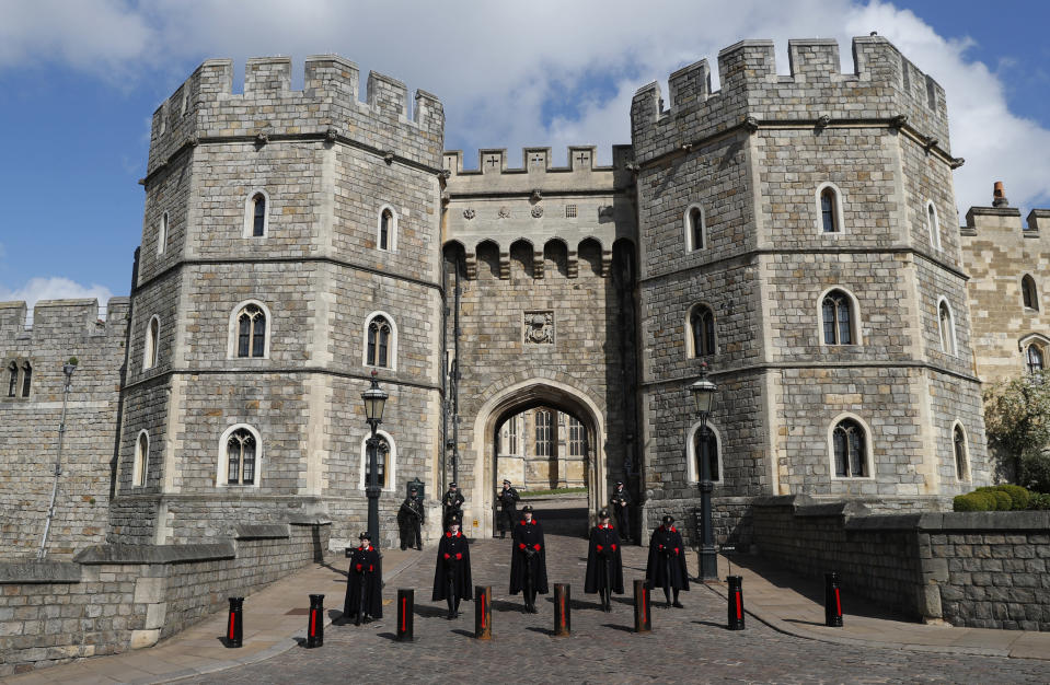 Wardens and armed police guard the Henry VIII gate in Windsor, England, Friday, April 16, 2021. Prince Philip husband of Britain's Queen Elizabeth II died April 9, aged 99, his funeral will take place Saturday at Windsor Castle in St George's Chapel. (AP Photo/Alastair Grant)