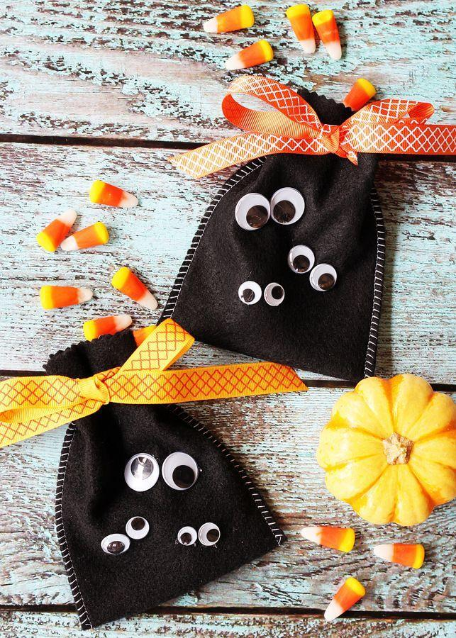 """<p>Embellished with three pairs of silly googly eyes, these goody bags are so simple it's scary. Tie off with a colorful ribbon for a sweet Halloween happy.</p><p><strong>Get the tutorial at <a href=""""http://www.positivelysplendid.com/halloween-treat-bag-craft/"""" rel=""""nofollow noopener"""" target=""""_blank"""" data-ylk=""""slk:Positively Splendid"""" class=""""link rapid-noclick-resp"""">Positively Splendid</a>.</strong> </p>"""
