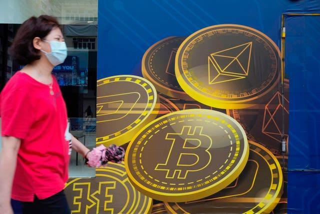 An advertisement for the Bitcoin cryptocurrency in Hong Kong (Vincent Yu/AP)